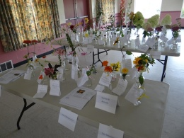 Annual flowers submitted in clear glass containers with wedging.